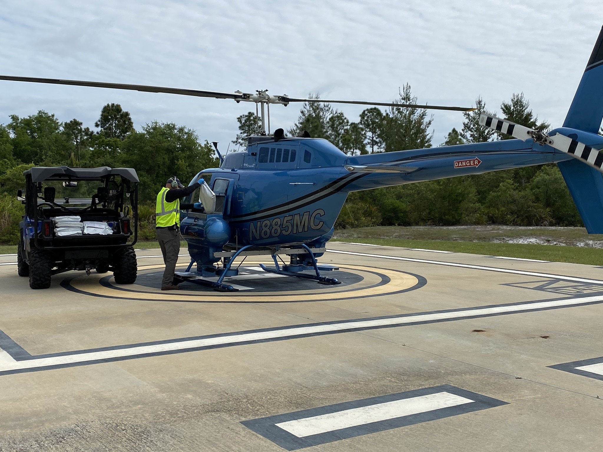 Loading Helicopter for larvicide mission